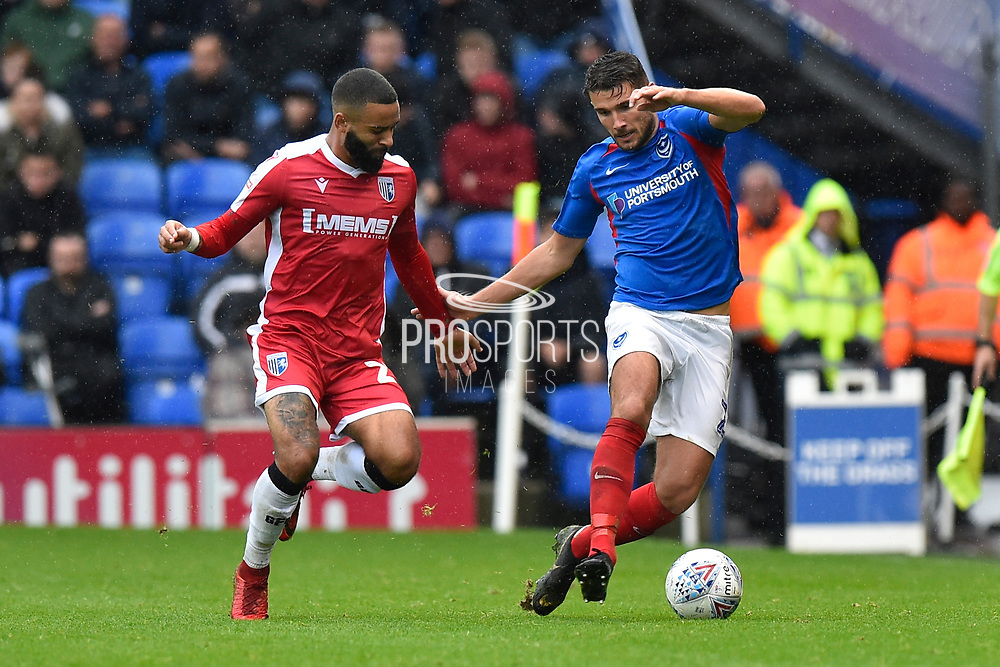 Gareth Evans (26) of Portsmouth battles for possession with Alex Jakubiak (23) of Gillingham during the EFL Sky Bet League 1 match between Portsmouth and Gillingham at Fratton Park, Portsmouth, England on 12 October 2019.