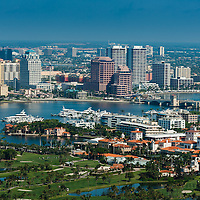 Aerial view of Palm Beach showing The Breakers golf course, Worth Avenue and West Palm Beach downtown business district .