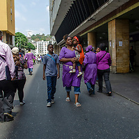 On Holy Wednesday, hundreds of Venezuelan believers dressed in purple attend the Basilica of Santa Teresa in Caracas to venerate and pay their promises to the Nazarene of St. Paul. This Holy Week tradition dates back to the 16th century, in gratitude to San Pablo El Ermitaño for stopping the smallpox epidemic that plagued the city. Caracas. Venezuela.