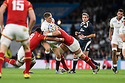 England fly half Owen Farrell is tackled by Wales back row Taulupe Faletau and Wales lock Alun Wyn Jones during the Rugby World Cup Pool A match between England and Wales at Twickenham, Richmond, United Kingdom on 26 September 2015. Photo by David Charbit.