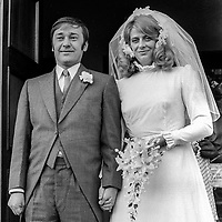 Bob Cooper, deputy leader, Alliance Party of N Ireland, with his bride, Patricia Nicholl after their wedding in St Brigid's RC Church, Derryvolgie Avenue, Belfast, on 2nd November 1974. 197411020602a<br />