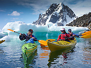 Kayaking off Petermann Island, home to the southernmost breeding colony of gentoo penguins, located below the Lemaire channel, near the Antarctic peninsula