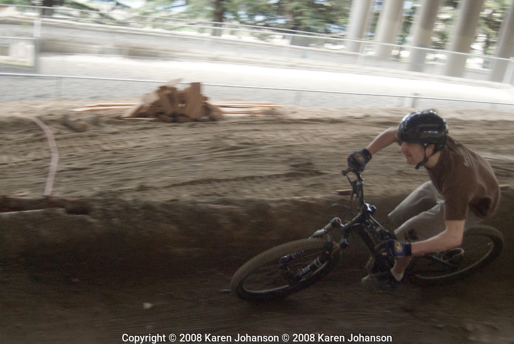 Kim Sturts tackles the drops, jumps and gaps of the expert line at the Colonnade bike skills park in Seattle, Wash.