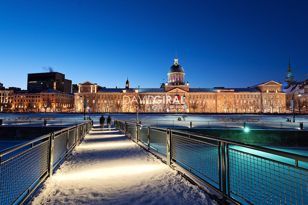 Picture of Marché Bonsecours Market and Montreal skyline at dusk and blue hour in winter, viewed from Parc des terrasses Bonsecours, Old Port, Old Montreal, Quebec, Canada