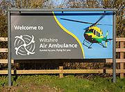 Sign at Air Ambulance charity helicopter emergency ambulance base, Semington, Wiltshire, England, UK