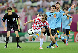(R) Spain's Sergio Busquets (nr16) fights for the ball with (L) Croatia's Luka Modric (nr10) during the UEFA EURO 2012 Group C football match between Spain and Croatia at Gdansk Arena in Gdansk on June 18, 2012...Poland, Gdansk, June 18, 2012..Picture also available in RAW (NEF) or TIFF format on special request...For editorial use only. Any commercial or promotional use requires permission...Photo by © Adam Nurkiewicz / Mediasport