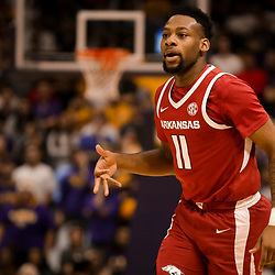 Feb 2, 2019; Baton Rouge, LA, USA; Arkansas Razorbacks guard Keyshawn Embery-Simpson (11) reacts after a three point basket against the LSU Tigers during the first half at the Maravich Assembly Center. Mandatory Credit: Derick E. Hingle-USA TODAY Sports