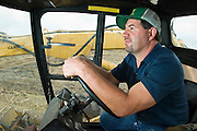 14 NOVEMBER 2005 - FRANKLIN, LA:  TODD MORRIS rests in the cab of the sugar cane loader on Jesse Breaux' near Franklin, Louisiana during the 2005 sugar cane harvest. Louisiana is one of the leading sugar cane producing states in the US and the economy in southern Louisiana, especially St. Mary and Iberia Parishes, is built around the cultivation of sugar. Sugar growers in the area are concerned that trade officials will eliminate sugar price supports during upcoming trade talks for the proposed Free Trade Area of the Americas (FTAA). They say elimination of price supports will devastate sugar growers in the US and the local economies of sugar growing areas. They also say it will ultimately lead to higher sugar prices for US consumers.   PHOTO BY JACK KURTZ
