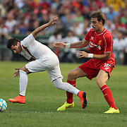 Juan Iturbe, (left), AS Roma, is challenged by Sebastián Coates, Liverpool, during the Liverpool Vs AS Roma friendly pre season football match at Fenway Park, Boston. USA. 23rd July 2014. Photo Tim Clayton