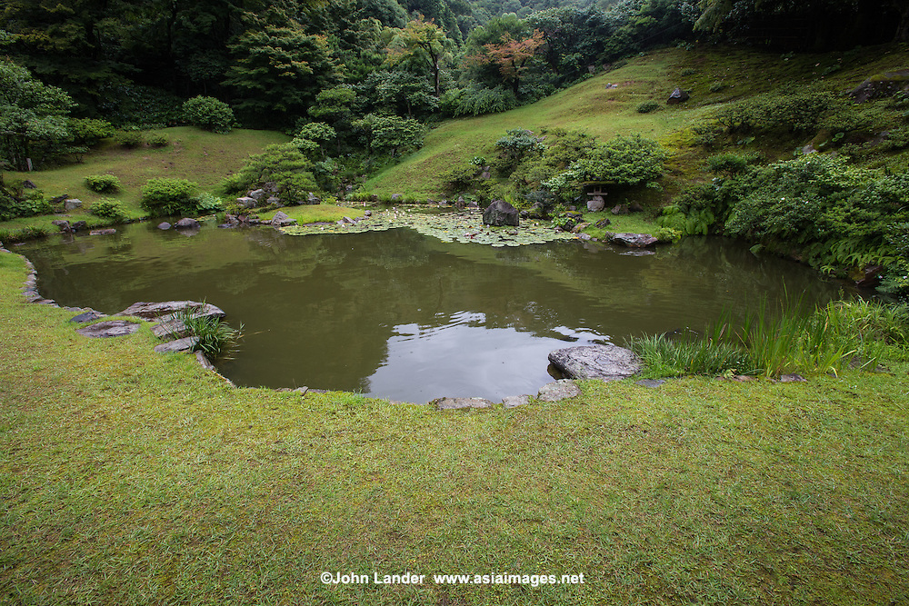 "Kannon-in Garden was built in the mid 17th century and artfully incorporates the forest behind the pond as its natural background.  This style is called Shakkei ""borrowed scenery"".  Kannon-in Garden was designated as a national scenic spot by the Japanese government."