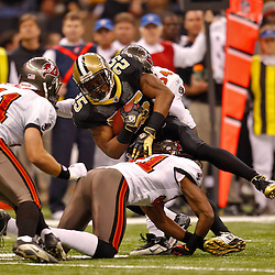 January 2, 2011; New Orleans, LA, USA; Tampa Bay Buccaneers defenders tackle New Orleans Saints running back Reggie Bush (25) during the first quarter at the Louisiana Superdome. Mandatory Credit: Derick E. Hingle