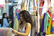 Astoria, New York<br /> March 30, 3016<br /> Kathy Vergara, 24, puts her clown uniform on a hanger after trying it on during a training she is leading at Blue Balloon Parties in Astoria, Queens on March 20, 2016.  She says she has a drastically different personality when inside her costume than out.  Vergara is also currently pregnant with twins.<br /> 3/30/16<br /> Tatiana Flowers/ CUNY Graduate School of Journalism)