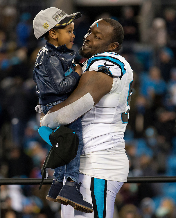 CHARLOTTE, NC - JAN 24:  Defensive end Charles Johnson #95 of the Carolina Panthers celebrates after the NFC Championship game against the Arizona Cardinals at Bank of America Stadium on January 24, 2016 in Charlotte, North Carolina.