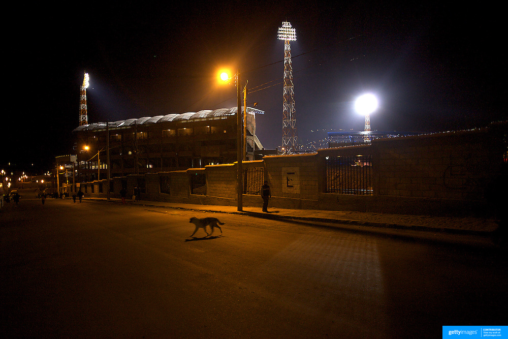 'Attitude at Altitude' Football in Potosi, Bolivia'..Fans arrive for a night match at the Estadio Victor Agustin Ugarte, home of Bolivian football team Real Potosi. Potosi, Bolivia, 12th May 2010. Photo Tim Clayton....'Attitude at Altitude' Football in Potosi, Bolivia'..The Calvario players greet the final whistle with joyous celebration, high fives and bear hugs the players are sprayed with local Potosina beer after a monumental 3-1 victory over arch rivals Galpes S.C. in the Liga Deportiva San Cristobal. The Cup Final, high in the hills over Potosi. Bolivia, is a scene familiar to many small local football leagues around the world, only this time the game isn't played on grass but a rock hard earth pitch amongst gravel and boulders and white lines that are as straight as a witches nose, The hard surface resembles the earth from Cerro Rico the huge mountain that overlooks the town. .. Sitting at 4,090M (13,420 Feet) above sea level the small mining community of Potosi, Bolivia is one of the highest cities in the world by elevation and sits 'sky high' in the hills of the land locked nation. ..Overlooking the city is the infamous mountain, Cerro Rico (rich mountain), a mountain conceived to be made of silver ore. It was the major supplier of silver for the spanish empire and has been mined since 1546, according to records 45,000 tons of pure silver were mined from Cerro Rico between 1556 and 1783, 9000 tons of which went to the Spanish Monarchy. The mountain produced fabulous wealth and became one of the largest and wealthiest cities in Latin America. The Extraordinary riches of Potosi were featured in Maguel de Cervantes famous novel 'Don Quixote'. One theory holds that the mint mark of Potosi, the letters PTSI superimposed on one another is the origin of the dollar sign...Today mainly zinc, lead, tin and small quantities of silver are extracted from the mine by over 100 co operatives and private mining companies who still mine the mountain in poor working condition