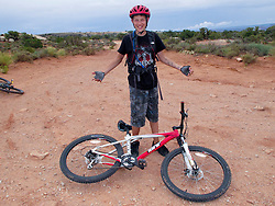 North America, United States, Utah, Dixie National Forest, Red Canyon, boy (age 12) with mountain bike.  MR ,