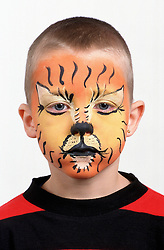 Portrait of young boy with painted face,