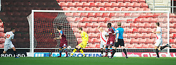SOUTHAMPTON, WALES - Saturday, October 9, 2010: Tranmere Rovers' goalkeeper Peter Gulacsi is beaten by Southampton's Adam Lallana for the second goal during the Football League One match at the St Mary's Stadium. (Pic by David Rawcliffe/Propaganda)