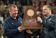 Head coach Tom Westerberg receives the UIL 5A state championship trophy from Gary Stocker during Allen High School's football state championship community celebration at the Allen Event Center on Wednesday, January 30, 2013 in Allen, Texas. (Cooper Neill/The Dallas Morning News)
