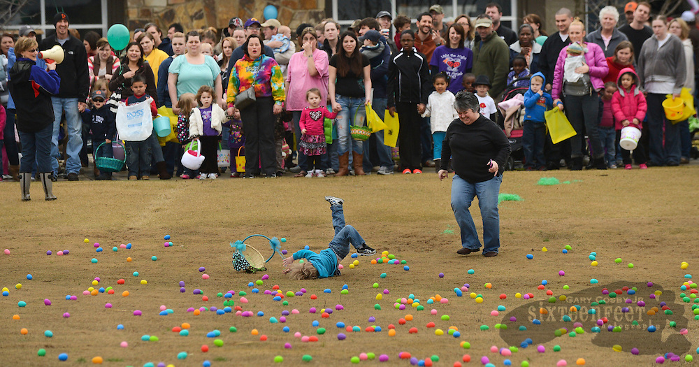Photo by Gary Cosby Jr.      Eggs galore, the Easter bunny and egg crafts draw a crowd to the Ingalls Pavilion area Saturday morning for the Eggstravaganza.  A very eager youngster takes a tumble after rushing onto the field just a little too early during one of the egg hunts.