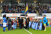 The players and dignitaries are led out by a Royal British Legion standard before the Vanarama National League match between Eastleigh and York City at Arena Stadium, Eastleigh, United Kingdom on 12 November 2016. Photo by Graham Hunt.