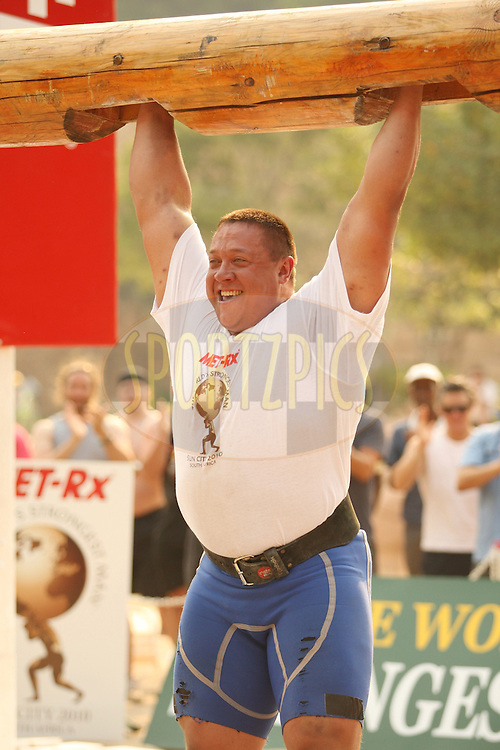 Mikhail Koklyaev (Russia) celebrates a successful attempt with a smile in the overhead log-lift during the final rounds of the World's Strongest Man competition held in Sun City, South Africa.