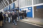 Fans queue at turnstiles for Cobbold Stand, Ipswich Town Football Club, Portman Road, Ipswich, Suffolk, England