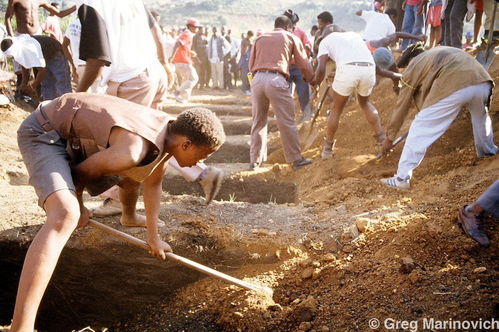 Table Mountain, KwaZulu Natal South Africa 1993: Inkatha supporters dig graves for the victims of an ambush during ANC  IFP clashes in Table Mountain area of Kwa Zulu Natal.