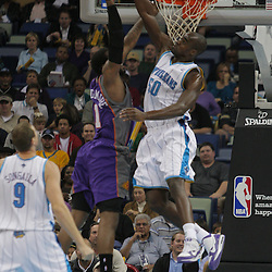 Nov 19, 2009; New Orleans, LA, USA;  New Orleans Hornets center Emeka Okafor (50) blocks a shot by Phoenix Suns forward Amare Stoudemire (1) during the first quarter at the New Orleans Arena. Mandatory Credit: Derick E. Hingle-US PRESSWIRE