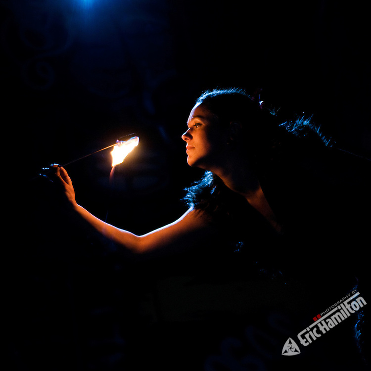Chelsea from Incendiary Circus, eating fire at the Great Salt Lake, 2008.