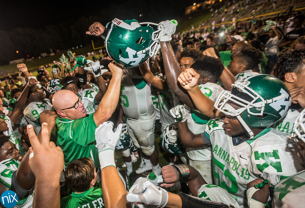 Kannapolis head coach Mike Newsome celebrates with his players after defeating Concord during the annual Battle for the Bell game at Concord High School Thursday night. Kannapolis won the game 31-19.