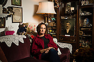 Judy Donovan, a descendent of Beaverton's historic Denney and Fanno families, poses with some of her family's antiques at her home in Beaverton. She is the Vice President of the Beaverton Historical Society.
