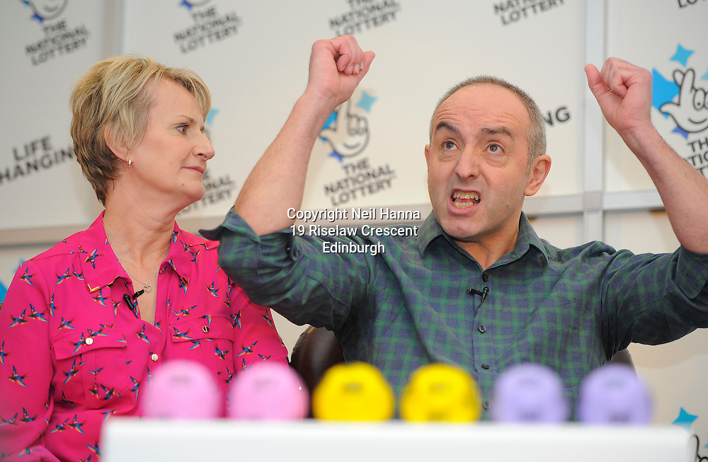 JP License<br /> A couple from Hawick in the Scottish Borders have been unveiled as the winners of half of last Saturday's record &pound;66m National Lottery jackpot.<br /> David and Carol Martin, both aged 54, appeared at a news conference at the Dalmahoy Hotel, south of Edinburgh.<br /> They were one of two ticket holders who matched the six winning numbers 26, 27, 46, 47, 52 and 58.<br /> The couple received a cheque for &pound;33,035,323. The record jackpot followed 14 consecutive rollovers.<br /> The Borders husband and wife said they were relaxing at home the following day with the lottery ticket on their mantelpiece and only checked it when a friend urged them to do so.<br />  Neil Hanna Photography<br /> www.neilhannaphotography.co.uk<br /> 07702 246823