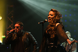 © Licensed to London News Pictures. 10/05/2012. London, UK.  Happy Mondays perform live at O2 Academy Brixton.  In picture L to R - Shaun Ryder (vocals), Rowetta Satchell (vocals).  Photo credit : Richard Isaac/LNP