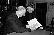 "21/5/1965<br /> 5/21/1965<br /> 21/5/1965<br /> <br /> President de Valera recived an inscribed mathematic textbook ""Matamatic na h'ard Teistimeireachta"" from the author An Br. Tomás Ó Catnain, Mount Sion Waterford.<br /> <br /> President de Valera receiving the book from An Br. Tomás Ó Catnain"