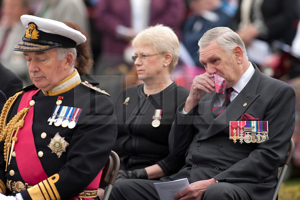 © Licensed to London News Pictures.20/05/2012, National Memorial Arboretum, Alrewas, Staffordhire, UK.The Service and Dedication of the Falklands Memorial at the National Memorial Arboretum took place earlier today. Pictured, an emotional day. Photo credit : Dave Warren/LNP