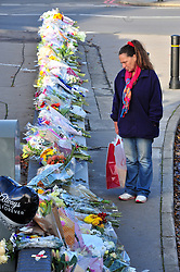 © Licensed to London News Pictures. 18/11/2016<br /> A woman looks at floral tributes at Sandilands Station in Croydon where the line re-opened at 12.30pm for the first time since the Croydon tram crash last week. Photo credit :Grant Falvey/LNP