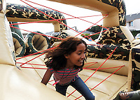 """Kids really enjoyed the gigantic inflatable """"Boot Camp"""" obstacle course at the event on Saturday night."""