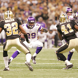 Jan 24, 2010; New Orleans, LA, USA; Minnesota Vikings running back Chester Taylor (29) runs as New Orleans Saints cornerback Jabari Greer (32) and safety Roman Harper (41) pursue during a 31-28 overtime victory by the New Orleans Saints over the Minnesota Vikings in the 2010 NFC Championship game at the Louisiana Superdome. Mandatory Credit: Derick E. Hingle-US PRESSWIRE