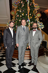 Left to right, JONNY ?, THOMAS KOCHS General Manager of Claridge's and NICHOLAS OAKWELL at the Claridge's Christmas Tree By Dolce & Gabbana Launch Party held at Claridge's, Brook Street, London on 26th November 2013.