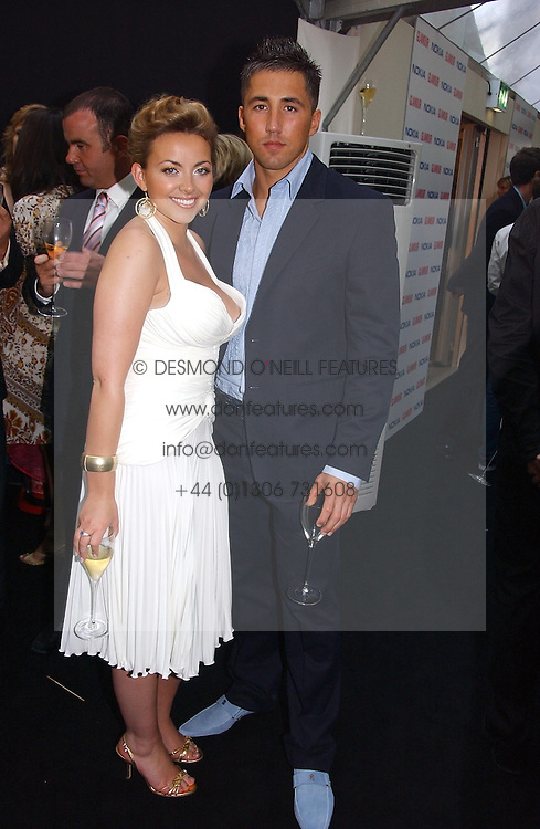 CHARLOTTE CHURCH and GAVIN HENSON at the 2006 Glamour Women of the Year Awards 2006 held in Berkeley Square Gardens, London W1 on 6th June 2006.<br />