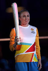 Sally Pearson with the Queen's baton during the Opening Ceremony for the 2018 Commonwealth Games at the Carrara Stadium in the Gold Coast, Australia.