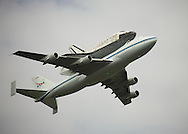 The Space Shuttle Discovery flying piggyback on specially modified jumbo jet over Arlington, VA, on it's way to Dulles Airport. On Thursday the shuttle will be towed from the airport to the adjacent Udvar-Hazy Center to embark on its new mission as a museum exhibit.