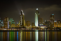 The downtown San Diego City skyline as it lights up the bay and water at night. Viewed from Coronado.
