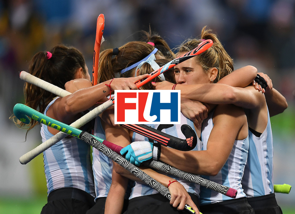 Argentina players celebrate a goal during the women's field hockey Britain vs Argentina match of the Rio 2016 Olympics Games at the Olympic Hockey Centre in Rio de Janeiro on August, 10 2016. / AFP / MANAN VATSYAYANA        (Photo credit should read MANAN VATSYAYANA/AFP/Getty Images)