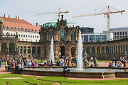 DRESDEN, GERMANY - MAY 22, 2010: Unidentified people relax next to the fountain in famous Zwinger palace in Dresden, Germany.