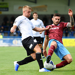 TELFORD COPYRIGHT MIKE SHERIDAN Darryl Knights of Telford battles with Liam Agnew of Gateshead during the National League North fixture between AFC Telford United and Gateshead FC at the New Bucks Head Stadium on Saturday, August 10, 2019<br /> <br /> Picture credit: Mike Sheridan<br /> <br /> MS201920-005