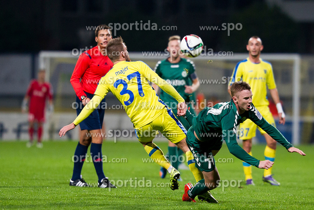 Zan Majer #37 of NK Domzale and Ziga Kastrevec #77 of NK Krka during football match between NK Domzale and NK Krka in 14th Round of Prva liga Telekom Slovenije 2015/16, on October 17, 2015 in Sports park Domzale, Slovenia. Photo by Urban Urbanc / Sportida