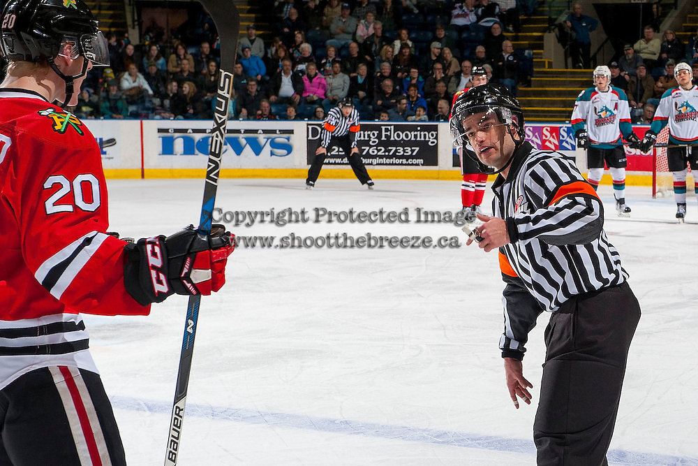 KELOWNA, CANADA - JANUARY 21: Referee Ryan Benbow makes a call to the Portland Winterhawks against the Kelowna Rockets on January 21, 2017 at Prospera Place in Kelowna, British Columbia, Canada.  (Photo by Marissa Baecker/Shoot the Breeze)  *** Local Caption ***