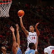 10 November 2017:  The San Diego State Aztecs men's basketball team opens up the season against San Diego Christian.San Diego State Aztecs forward Nolan Narain (24) attempts a shot over San Diego Christian Hawks defenders in the first half. The Aztecs lead the Hawks 46-24 at the half.<br /> www.sdsuaztecphotos.com