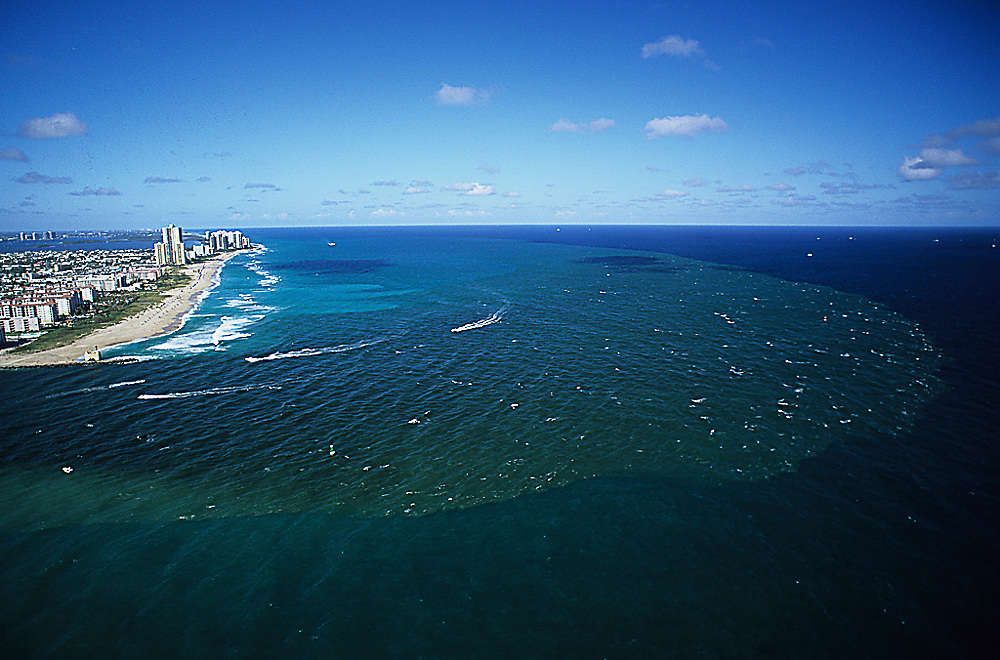 The outgoing tide in the Palm Beach Inlet releases millions of gallons of polluted water into the Atlantic Ocean offshore Singer Island, Florida, United States.